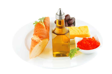olive oil,caviar, and baguette over white plate Stock Photo