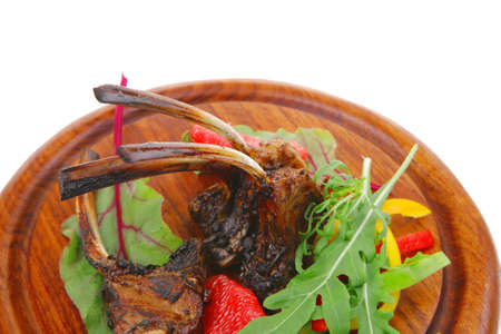 meat food : roast ribs on wooden plate with rocket leaves and grapefruit isolated over white background photo