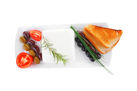 soft white cheese with bright toast and olives photo
