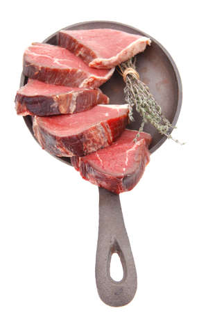 bloody raw beef meat on pan isolated on white background photo