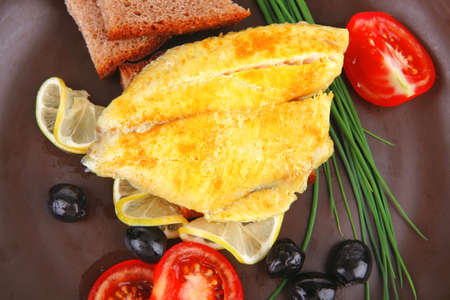 served roast golden fish fillet with tomatoes, rye bread and olives Stock Photo - 15883909