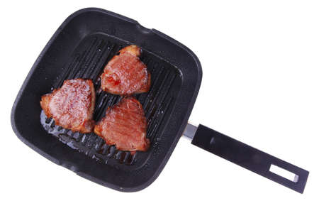 roast bloody beef fillet steaks on black  grill plate isolated on white background Stock Photo - 15882461