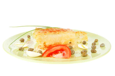 meatless: food : cheese casserole piece on green plate served with capers and tomatoes isolated over white Stock Photo