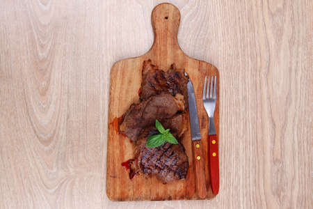 bbq beef meat fillet on wooden plate with cutlery Stock Photo - 15883944