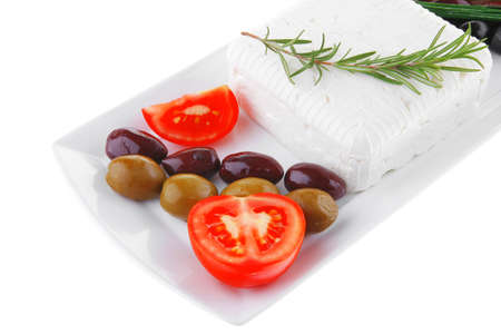 image feta cube and olive over white plate with bread photo