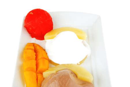 brylle: ice cream on pineapple with mango on plate Stock Photo