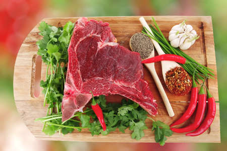 circular muscle: butchery : fresh raw beef lamb big rib ready to cooking with green stuff on wooden plate isolated over white background
