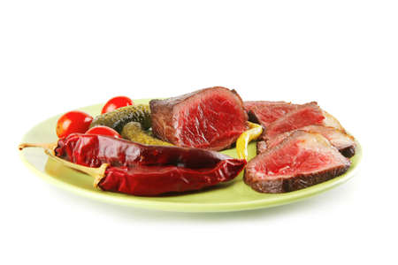 meat slices and chunk with vegetables and peppers photo