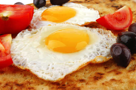 fried eggs on pancake over white with vegetables Stock Photo - 16148279