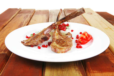 meat portion: barbecued ribs served with rice and tomatoes on white over wood photo