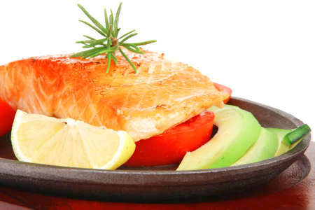 food: hot grilled salmon on metal pan over wooden plate isolated on white background Stock Photo - 16148497