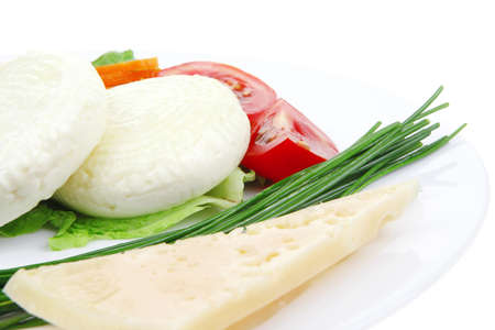 sustained: aged cheese : parmesan roquefort and gruyere chops delicatessen cheeses and soft feta on plate isolated over white background