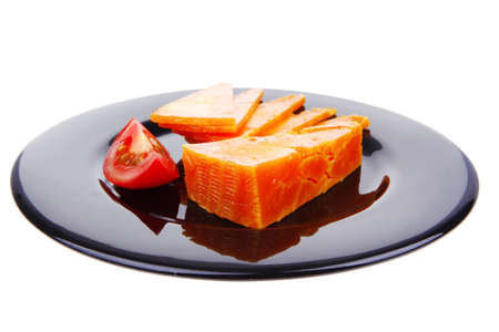 sustained: old delicious cheddar cheese chop with slice on black plate isolated over white background