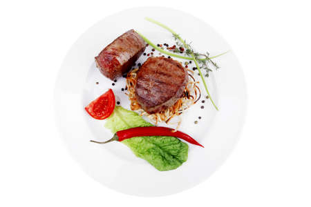 grilled beef fillet medallions with thyme and red hot chili pepper on plate isolated over white background Stock Photo - 16148754