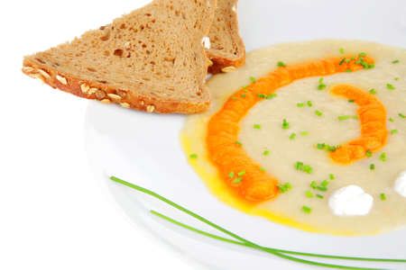 homemade cuisine : isolated salmon soup served with bread and pepper on white dish photo