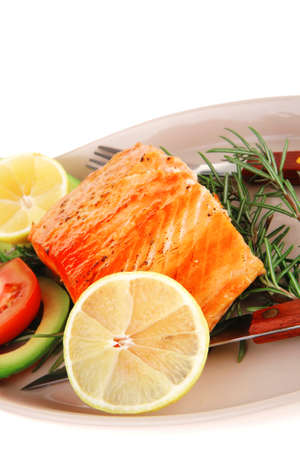 served fish: roast salmon fish over glass plate isolated over white background Stock Photo - 16237586