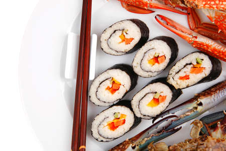 Maki Sushi : Maki Rolls and California rolls made of fresh raw Salmon, Tuna and Eel . on black dish with red and blue crabs . Stock Photo - 16315303