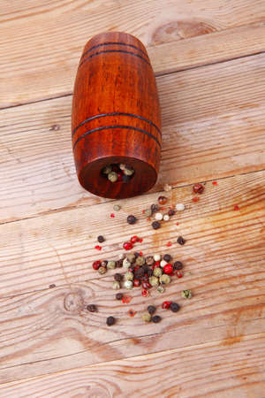 dry pepper with castor on wood photo