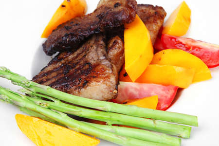 meat food : rare medium roast beef fillet with mango tomatoes and asparagus , served on white dish over wooden table Stock Photo - 16315364