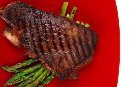 meat table : rare medium roast beef fillet asparagus served on red dish isolated over white Stock Photo - 16315397