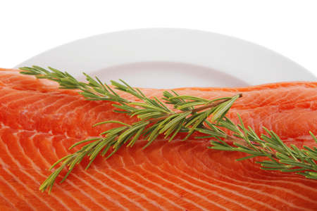 raw salmon fillet isolated on white with rosemary Stock Photo - 16315330