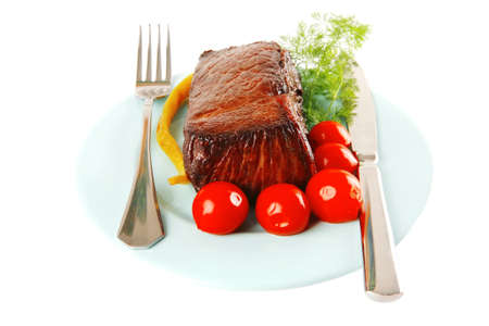 meat and vegetables on blue dish with pepper photo
