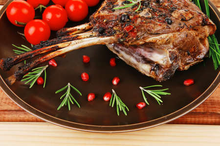 charbroiled: served charbroiled ribs on plate over wood