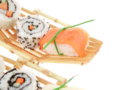 Maki Sushi and Sashimi - California Roll with Avocado and Salmon, Cream Cheese and Raw Salmon inside. Sahimi topped with raw Salmon and Eel . isolated over white background photo