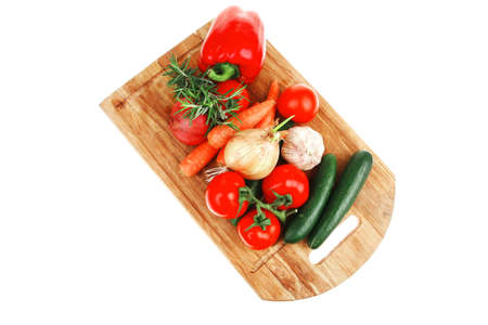 collection of raw vegetables on kitchen wooden board isolated over white background Stock Photo - 16738016