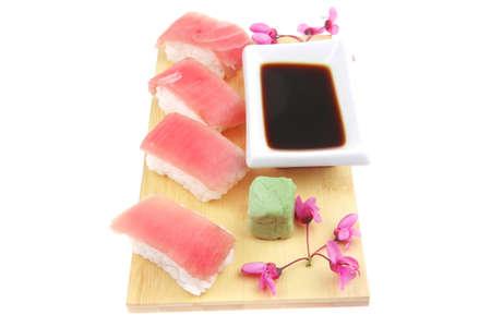 soysauce: Nigiri Sushi - Set of Nigiri sushi topped with raw Tuna (maguro) . isolated over white background . on wooden board