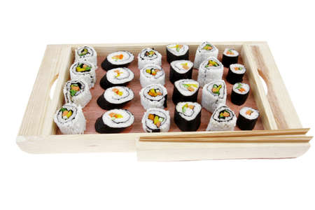 soysauce: Japanese traditional Cuisine - Roll with Cucumber , Cream Cheese with raw Tuna and Salmon inside. on wooden board . Isolated over white background