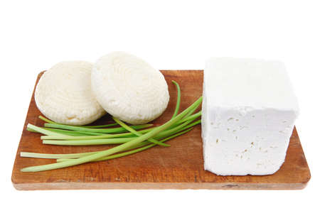 diet food : greek feta white cheese served on small wooden plate isolated over white background Stock Photo