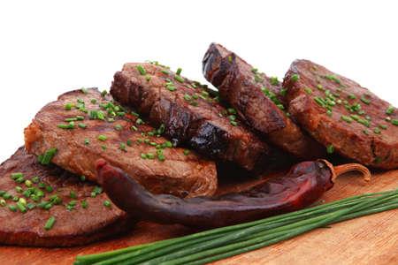 beef meat: fresh ripe roasted beef meat on wooden plate with thyme and chives isolated on white background