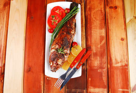 savory on wood: whole fryed sunfish over plate with tomatoes lemons and peppers photo