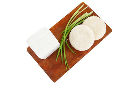 dairy food : feta white cheese cubes on cut wooden plate isolated over white background photo