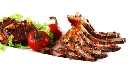 beef meat served on ceramic plate with pepper photo
