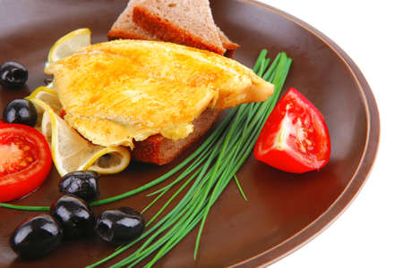 grilled fish fillet served with tomatoes,olives and bread Stock Photo - 16989891