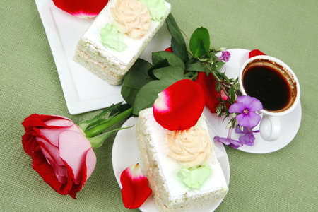 sweet breakfast : whipped cream cake with roses and hot black coffee Stock Photo - 16990047