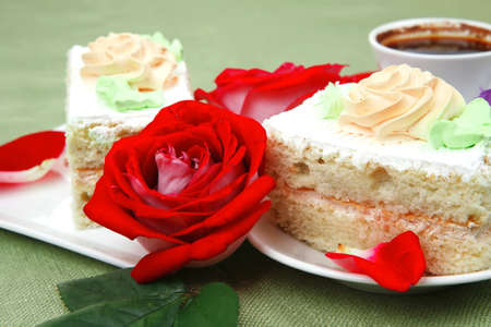 sweet breakfast : whipped cream cake with roses and hot black coffee Stock Photo - 16989883