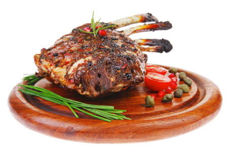 grilled ribs with vegetables on white background photo