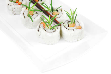 Maki Sushi - California Roll made of Raw Salmon, Cream Cheese and Deep Fried Vegetables inside. With wasabi and ginger. isolated over white background Stock Photo - 17071571