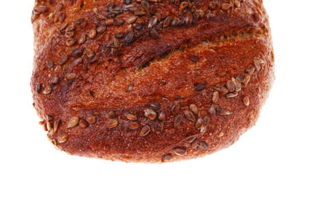 bun of big french rye bread topped with sunflower seeds isolated over white background photo