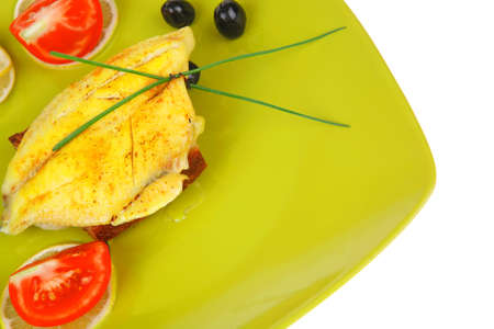 roast fish fillet served on bread with tomatoes,olives and chives photo