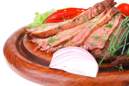 hot beef on wooden plate over white photo