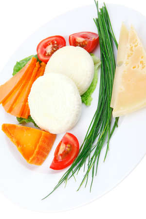 sustained: french cheeses : delicatessen aged cheeses with soft feta chops served on white plate with slices isolated on white background