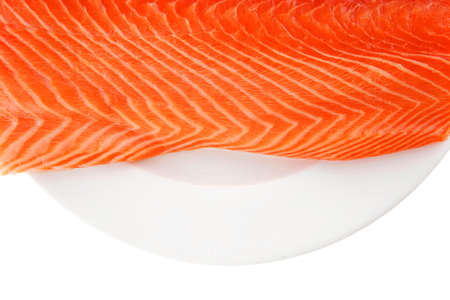 fresh uncooked salmon fillet on white plate photo