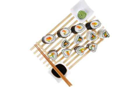 Maki Roll with Deep Fried Vegetables inside . on wooden grid . isolated over white background . Japanese Cuisine Stock Photo - 17511947