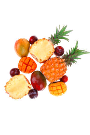 exotic fruit food - a lot of fresh raw tropical fruits include pineapple mango and red plums isolated over white background Stock Photo - 17527603