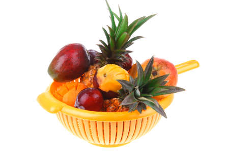 diet food - set of lot of tropical fruits include pineapple plum and mango in orange colander isolated over white background Stock Photo - 17524841