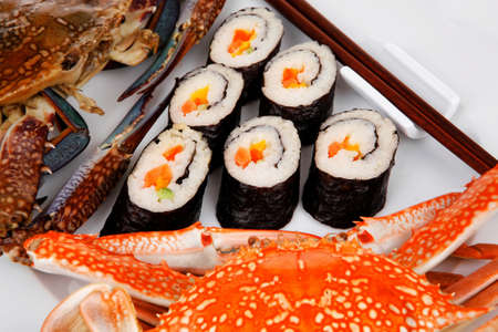 Japanese Traditional Cuisine - California Roll with Avocado and Salmon, Cream Cheese . on black dish with red and blue crabs . Stock Photo - 17738461